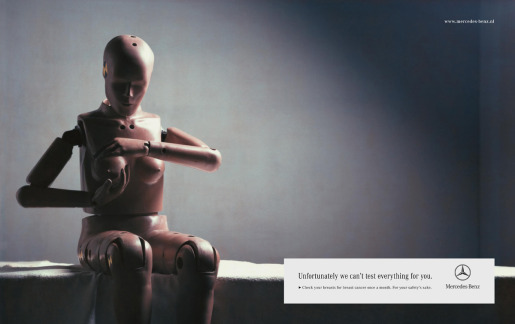 photo of Mercedes ad with test mannequin doing a breast exam