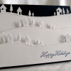photo of pop up holiday card with trees and snow